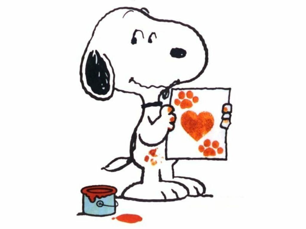 O snoopy drwaing his own valentine card